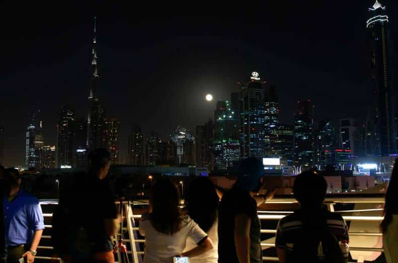 Enthusiasts watch the Supermoon, which is largest and brightest seen from earth in 69 years, over Business Bay.