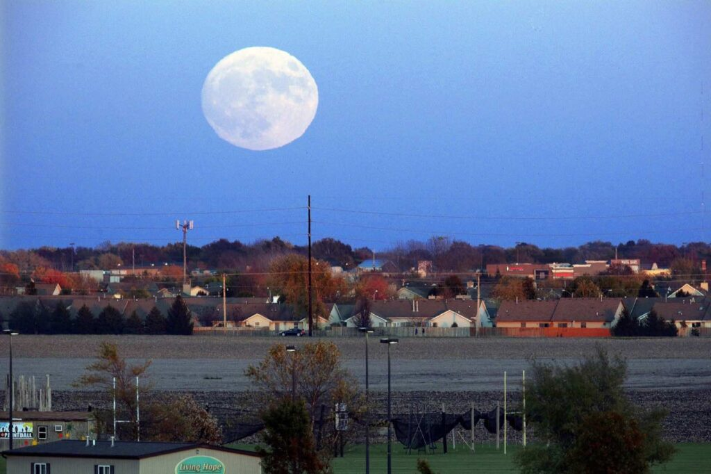 The moon rises over Springfield, Ill., Sunday, Nov. 13, 2016. On Monday the so-called 'supermoon' will be the closest full moon to earth since 1948, and it won't be as close again until 2034. ?(AP Photo/Seth Perlman)