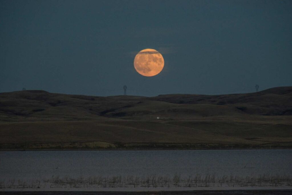 The supermoon rises over the Missouri River, pictured from the Standing Rock Indian Reservation near Cannon Ball, North Dakota, U.S. November 13, 2016. REUTERS/Stephanie Keith