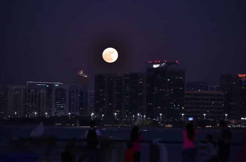 People watching supermoon at Abu Dhabi break water.