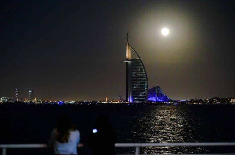 Supermoon rise over the skyline of Dubai.
