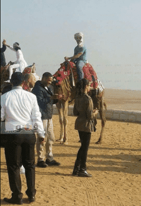 Will Smith riding camel in the Pyramids area